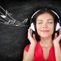 bigstock-Music--woman-wearing-headphon-48690104
